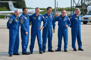 "Space shuttle Endeavour's final crew arrives in Florida on May 12 for their May 16, 2011 scheduled launch. From left to right: Mark Kelly, commander; Greg Chamitoff, Drew Feustel, Roberto Vittori and Mike Fincke, all mission specialists; and Greg H. ""Box"""