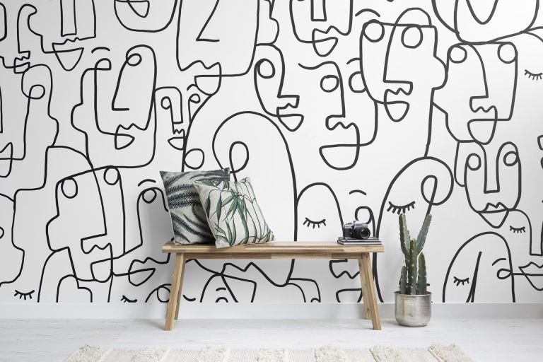Monochrome wall mural with abstract faces pattern