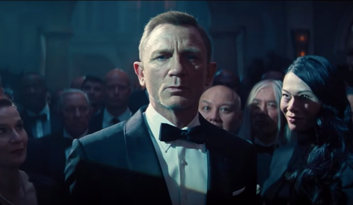 No Time To Die Daniel Craig surrounded by staring onlookers