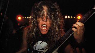 James Hetfield playing guitar
