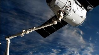 Used SpaceX Dragon Cargo Ship Arrives at Space Station for Record 3rd Time