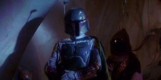 Boba Fett (Jeremy Bulloch) stands in Jabba's Palace in Return of the Jedi (1983)