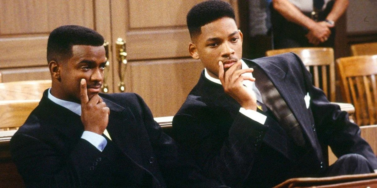 Carlton Banks (Alfonso Ribeiro) and Will Smith (himself) look curious on The Fresh Prince of Bel-Air