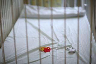 An empty baby crib.