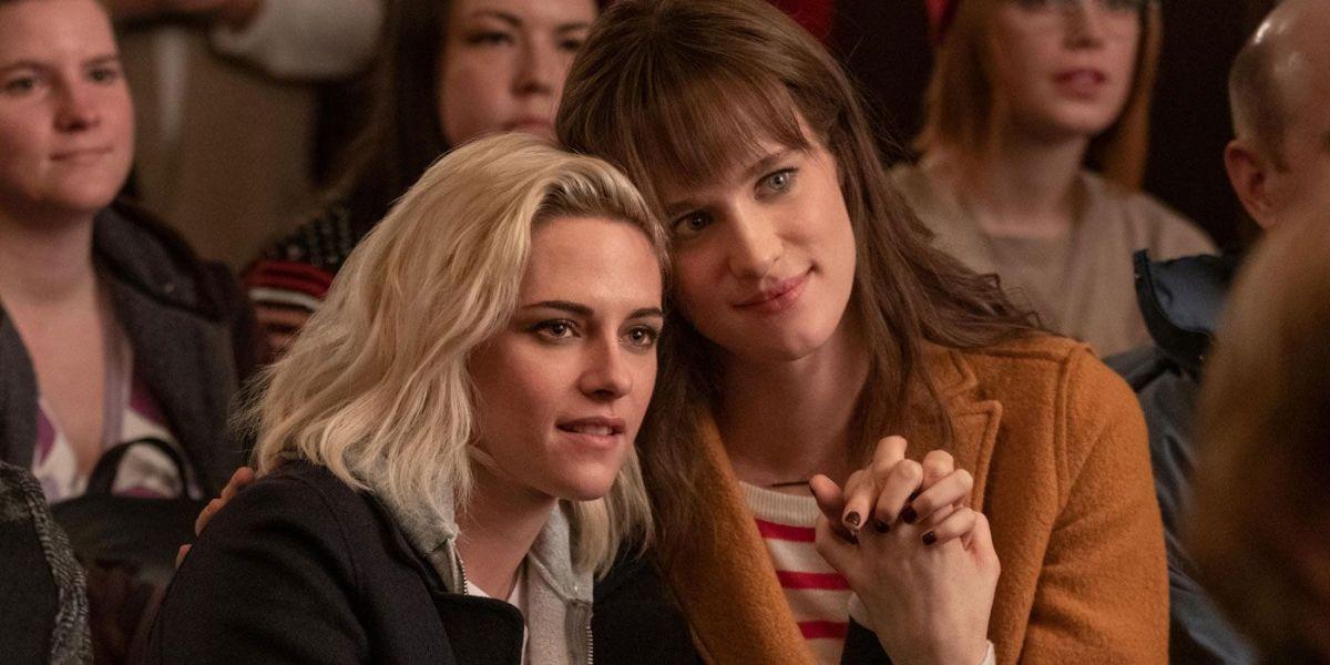 Kristen Stewart as Abby Holland alongside Mackenzie Davis in Happiest Season.