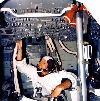 Apollo 15 astronaut Al Worden inside a command module simulator prior to the 1971 moon landing mission.