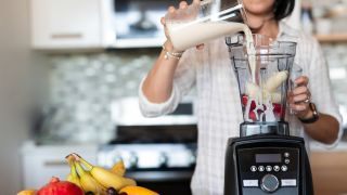 Woman blending a smoothie