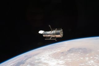 The Hubble Space Telescope seen orbiting Earth.