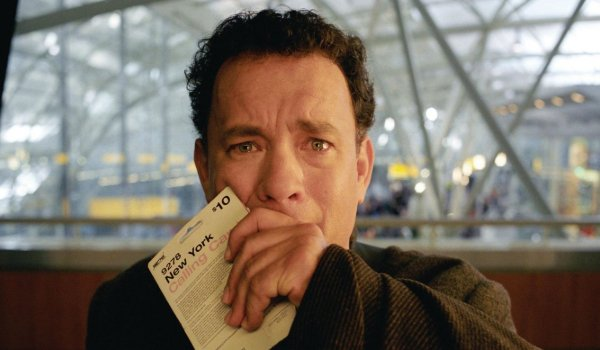 The Terminal Tom Hanks crying while watching the news at the airport