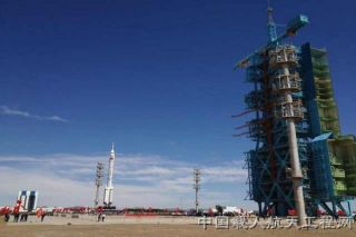 China Long March 2F rocket rolls out to launch pad for Shenzhou 9 mission in June 2012.