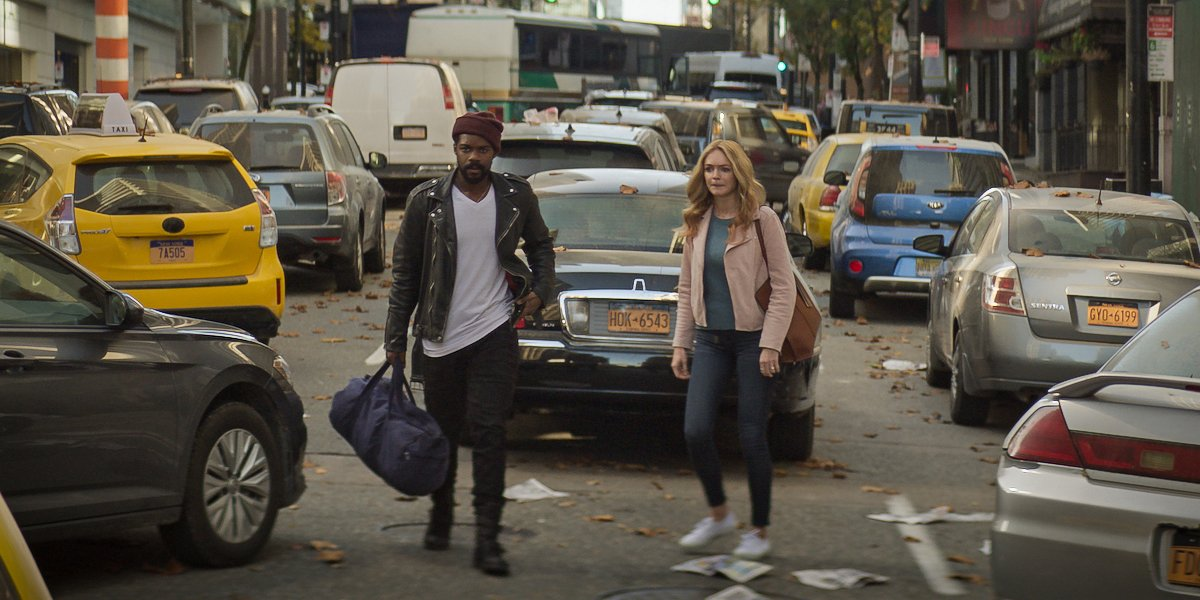 Jovan Adepo and Heather Graham walk the streets of New York In the stand