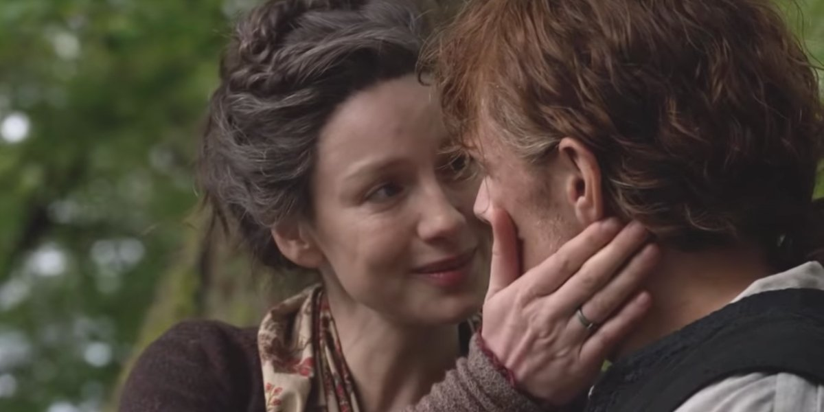 Claire and Jamie sharing a tender moment in Season 4 of Outlander