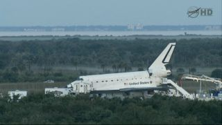 Space shuttle Atlantis on runway after final landing