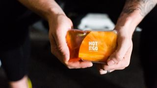Best handwarmers: two hands holding a pack of Hot to Go hand warmers
