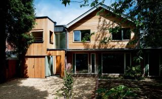 A 1970s home on a Hampshire cul-de-sac has been transformed into a modern, eco-friendly timber clad home.