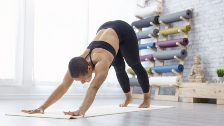 Woman doing a 30-minute strength workout to undo the damage of sitting