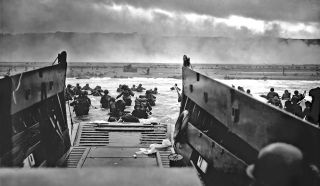 Coast Guard Chief Photographer's Mate Robert F. Sargent captured this famous D-Day image of the scene on Omaha Beach at about 7:40 a.m. on June 6, 1944.