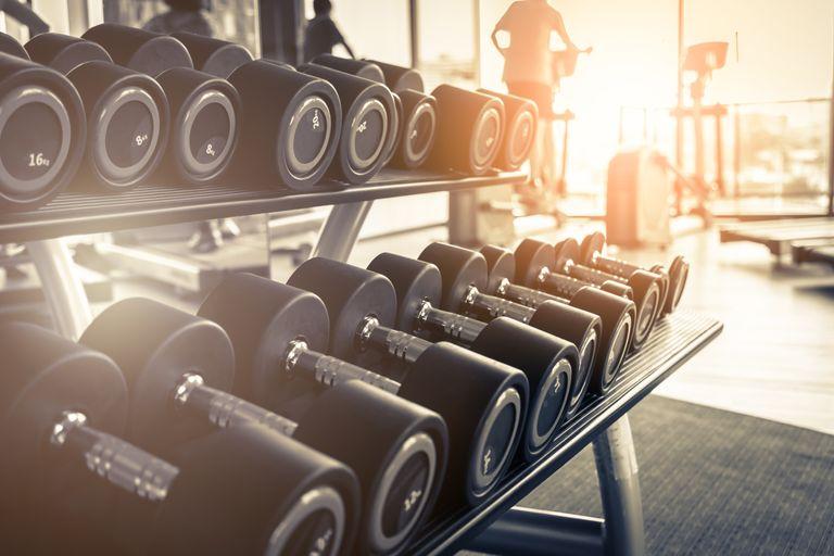 Best dumbbells: lifestyle image of dumbbells lined up in gym
