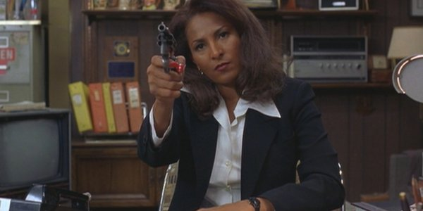 Jackie Brown Pam Grier controlling the room with a revolver