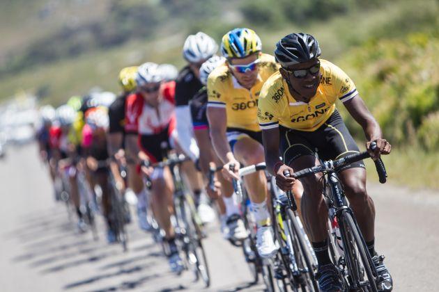 1b4a01829 Nicholas Dlamini in the 360NE amateur leader s jersey with Team Bulls rider  Karl Platt on his