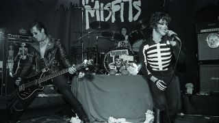 A photograph of the Misfits on stage in 1979