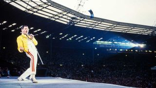 Freddie Mercury onstage with Queen at Wembley stadium during the Magic tour