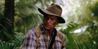 Dr. Grant (Sam Neill) walks through the woods in a scene from Jurassic Park III.