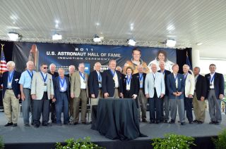 "Shuttle commander Karol ""Bo"" Bobko and station spacewalker Lt. Gen. Susan Helms are flanked by their fellow Hall of Fame astronauts at their induction ceremony, May 7, 2011 at the Kennedy Space Center Visitor Complex."