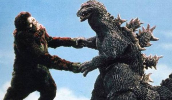 King Kong vs Godzilla battling in front of the sky