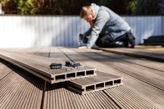 man installing decking