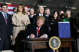 President Donald Trump signs S.1790, the National Defense Authorization Act for Fiscal Year 2020 on, Friday, Dec. 20, 2019 at Joint Base Andrews. The act directed the establishment of the U.S. Space Force as the sixth branch of the armed forces.