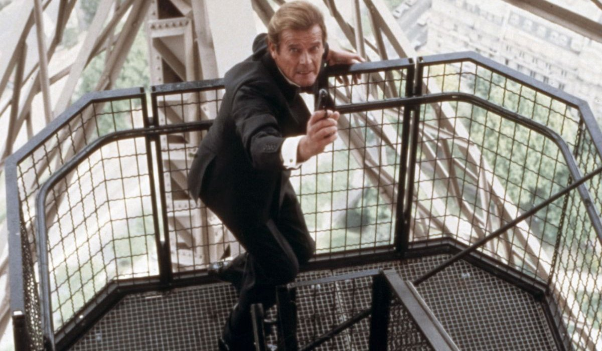 A View To A Kill Roger Moore aims his gun in a tuxedo