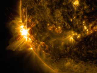 A massive X2.2 solar flare erupts off the left limb of the sun in this view captured by NASA's Solar Dynamics Observatory on June 10, 2014, at 7:41 a.m. EDT.
