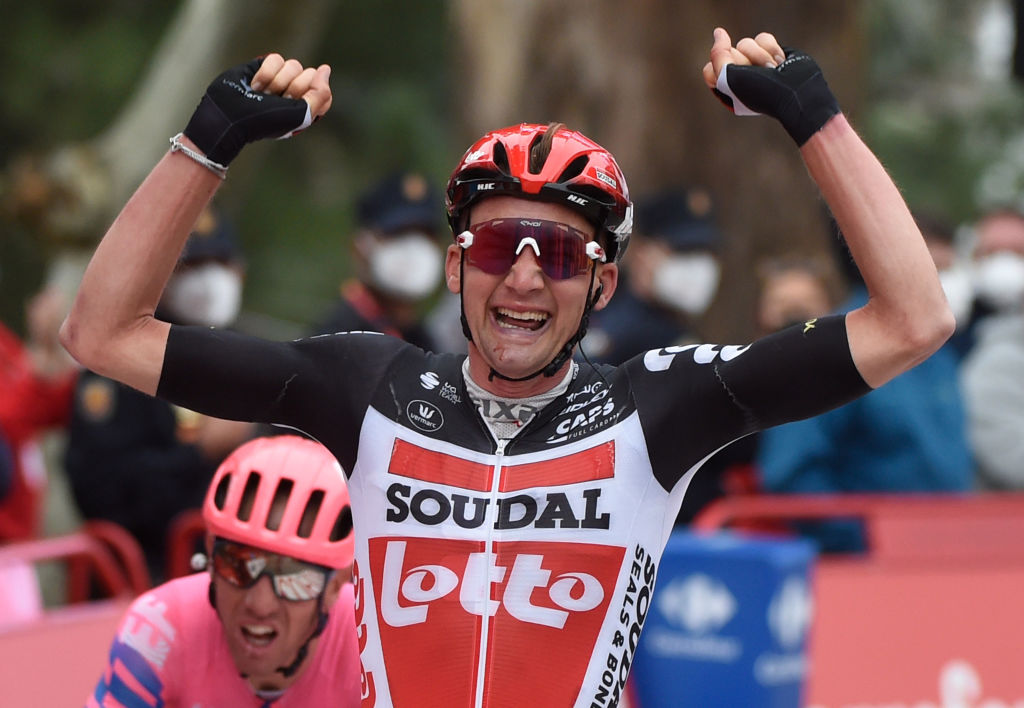 Team Lotto rider Belgiums Tim Wellens celebrates as he crosses the finish line of the 14th stage of the 2020 La Vuelta cycling tour of Spain a 2047km race from Lugo to Ourense on November 4 2020 Photo by MIGUEL RIOPA AFP Photo by MIGUEL RIOPAAFP via Getty Images