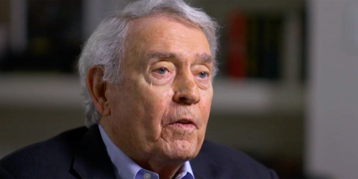 Dan Rather looking at his subject during an interview.