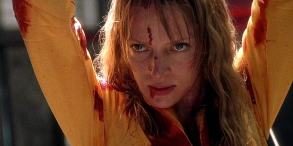 The Bride raises her hands above her head in 'Kill Bill Vol. 1'