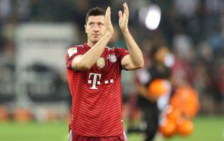 Bayern Munich striker Robert Lewandowski applauding the fans