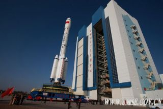 China's Tiangong 1 space lab and its Chinese Long March 2F rocket is transferred to the launch site.