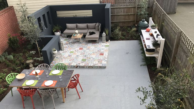 Patterned paving and an outdoor kitchen area