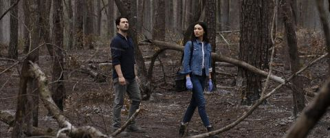 Alec Holland and Abby Arcane wander through a rotten forest