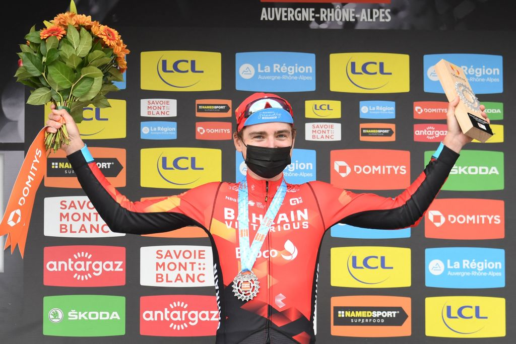 Stage winner Team Bahrains Mark Padun of Ukraine celebrates on the podium after winning the eighth stage of the 73rd edition of the Criterium du Dauphine cycling race a 147km between La LechereLesBains and Les Gets on June 6 2021 Photo by Alain JOCARD AFP Photo by ALAIN JOCARDAFP via Getty Images