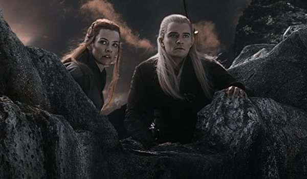 The Hobbit :The Battle of Five Armies Evangeline Lilly and Orlando Bloom spot something on the cliff