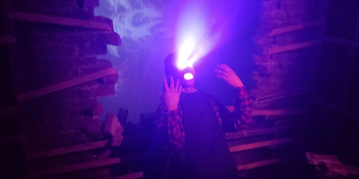 man with glowing eyes and mouth in legendary truth haunted maze at universal studios orlando halloween horror nights
