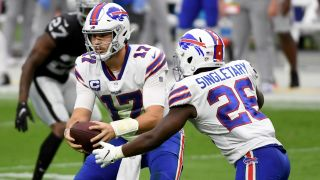 Quarterback Josh Allen of the Buffalo Bills hands the ball off to running back Devin Singletary in a game against the Las Vegas Raiders on October 4, 2020 in Las Vegas. He'll look to keep his team undefeated Tuesday.