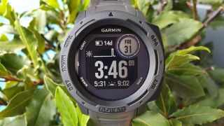 Close-up of Garmin Instinct Solar's face, showing time and date