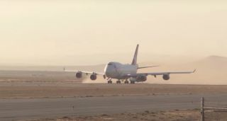 """Virgin Orbit's carrier plane, known as Cosmic Girl, heads down the runway at California's Mojave Air and Space Port on June 30, 2021, kicking off the """"Tubular Bells: Part One"""" mission."""