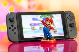Stock image of Mario and a Nintendo Switch