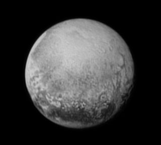 Image of Pluto captured by NASA's New Horizons spacecraft on July 11, 2015. The photo shows linear features that may be cliffs, as well as a large circular feature that could be an impact crater.