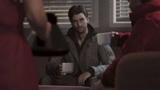 Alan Wake sitting down in a motel with a cup of coffee in Remastered