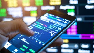Checking the stock exchange with an online stock trading app open